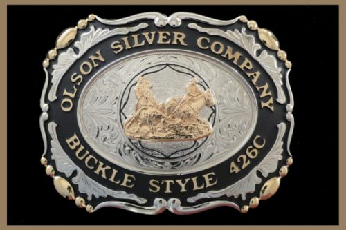 Custom belt buckle with black accents, scallop shaped