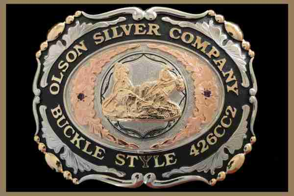 Custom belt buckle with black accents, scallop shaped and stones