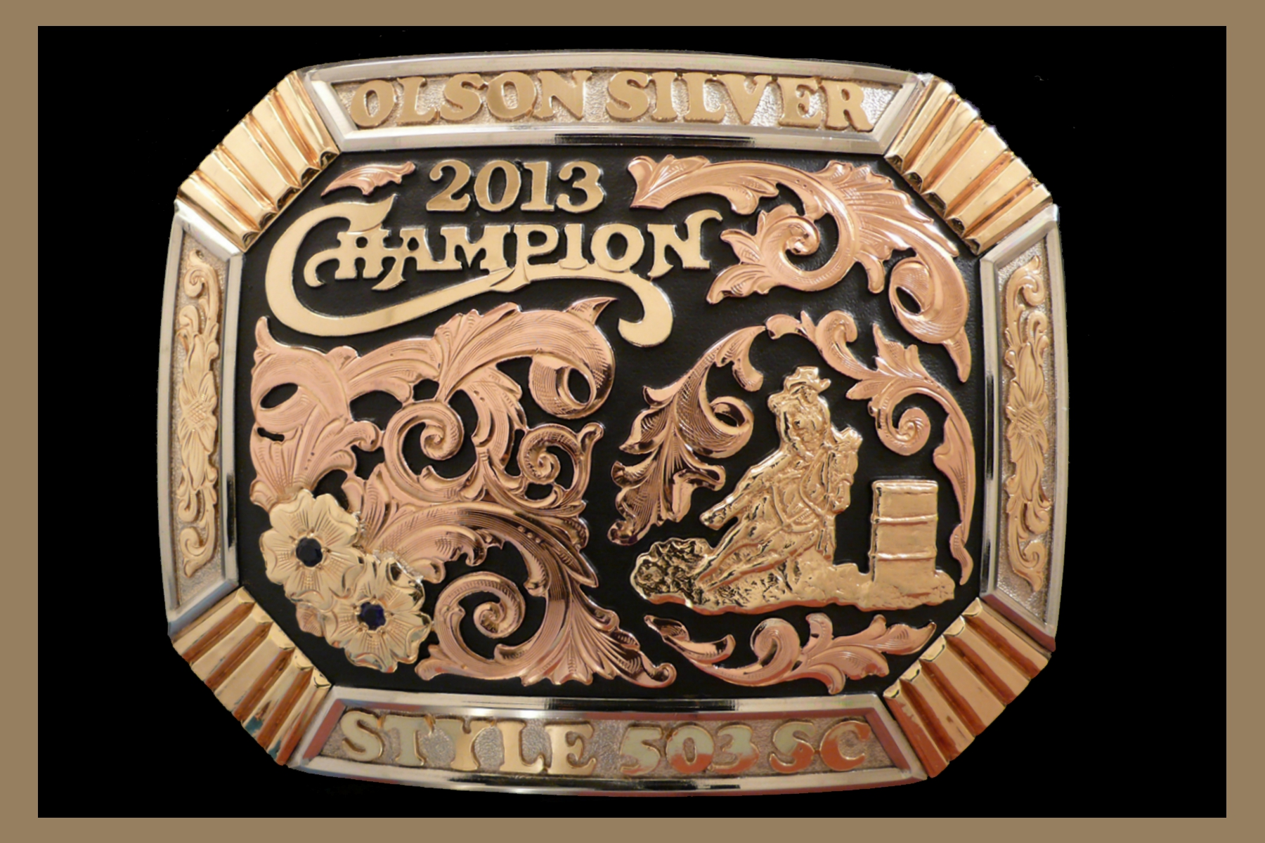 Custom trophy buckle with black background and stones